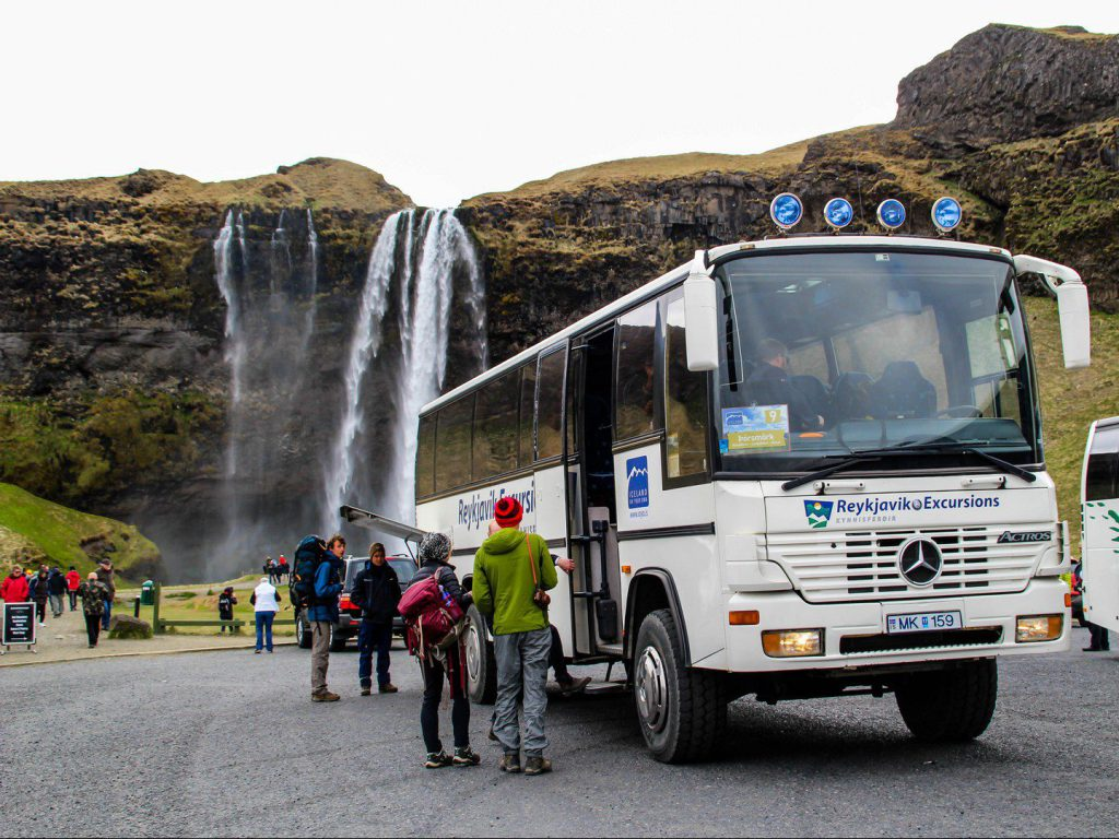 4WD bus at parking lot Seljalandsfoss waterfall Iceland