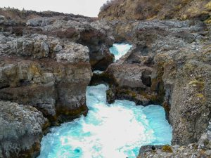 Fast-flowing water at Barnafoss waterfall Iceland
