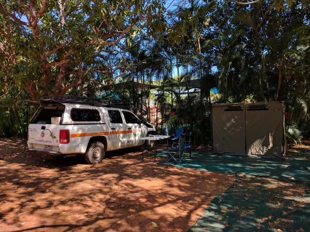 Tent and camping chairs next to 4WD on campsit Broome Australia