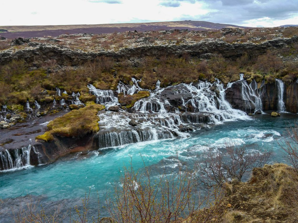 Hraunfossar waterfall flows from lava field Hallmundarhraun Iceland