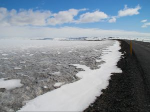 Road to Dettifoss across lava fields covered with ice Iceland