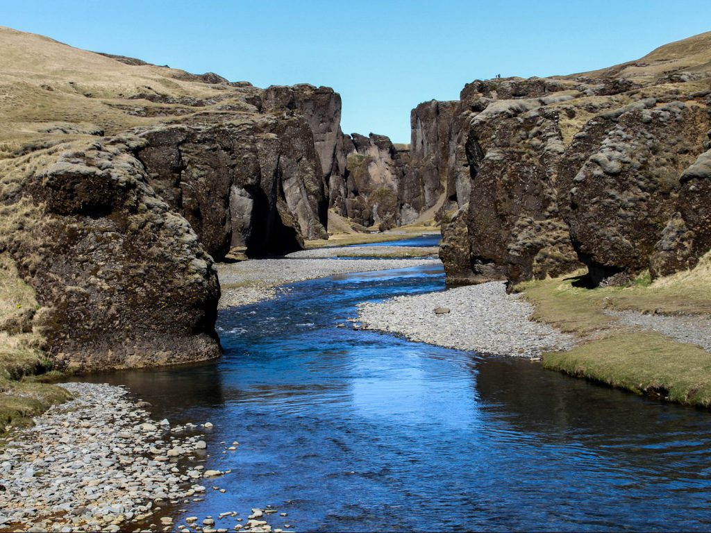 River runs through Fjaðrárgljúfur canyon Iceland