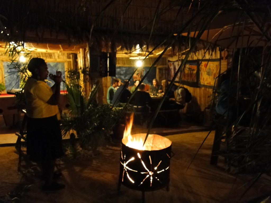 Singer and fire basket at night at Lebo's Soweto Backpackers Johannesburg South Africa