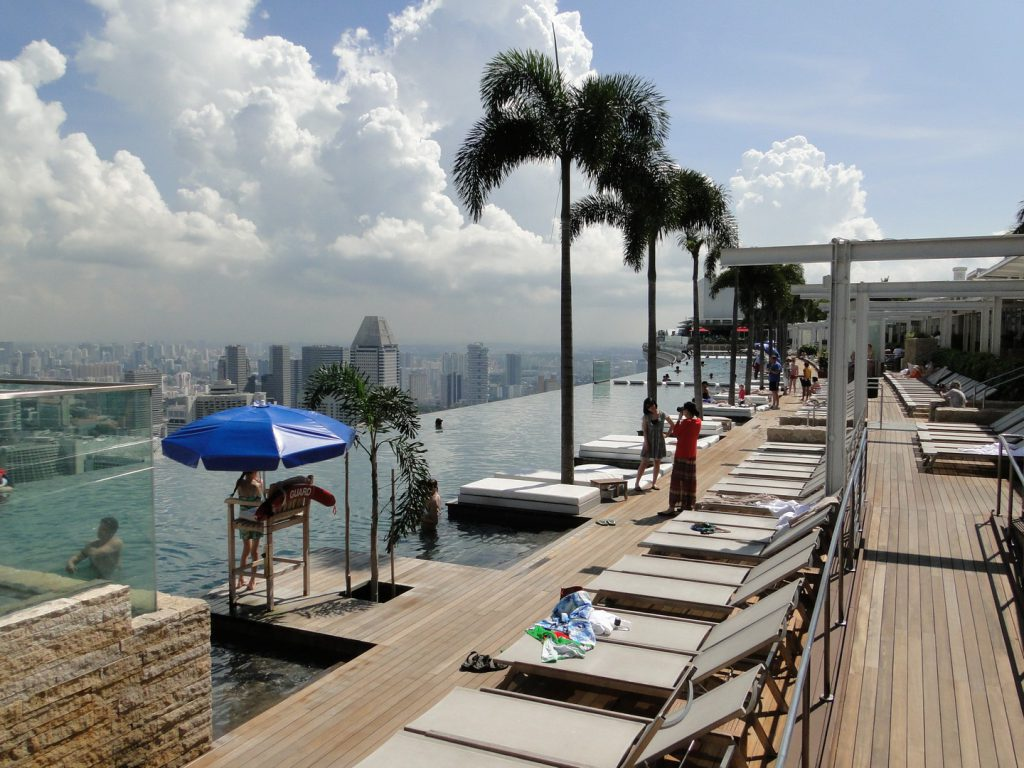 Sunbeds at infinity pool Marina Bay Sands hotel Singapore