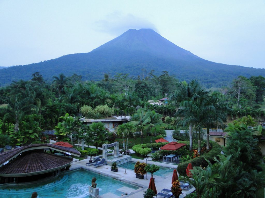 View Arenal volcano from swimming pool La Fortuna Costa Rica