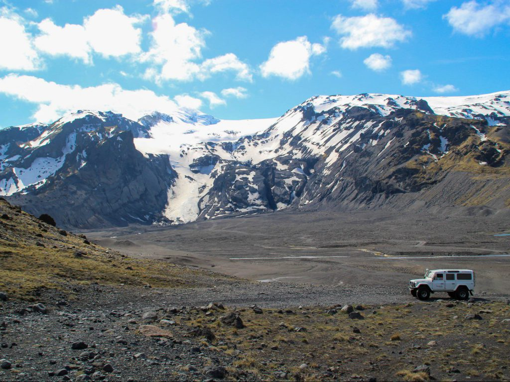 4WD jeep is parked at the foot of Gígjökull glacier Þórsmörk Iceland
