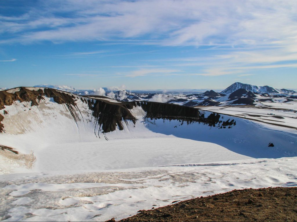 The Víti explosion crater and surrounding mountains on Iceland covered with snow