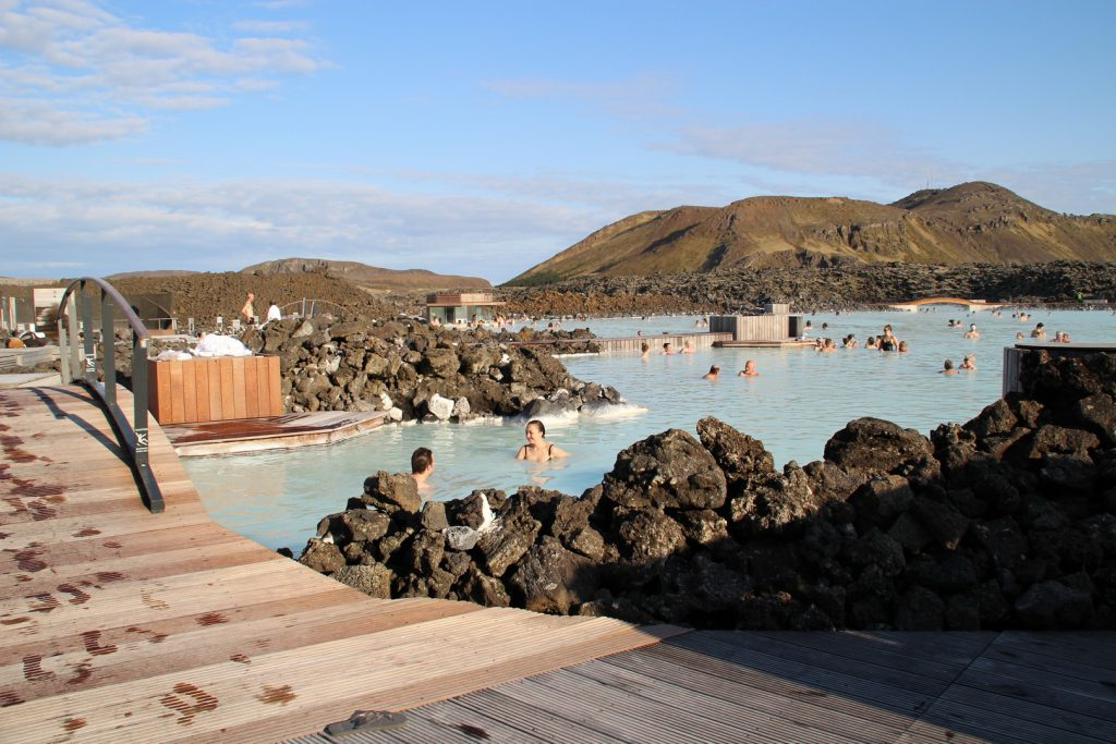Visitors swimming Blue Lagoon Iceland