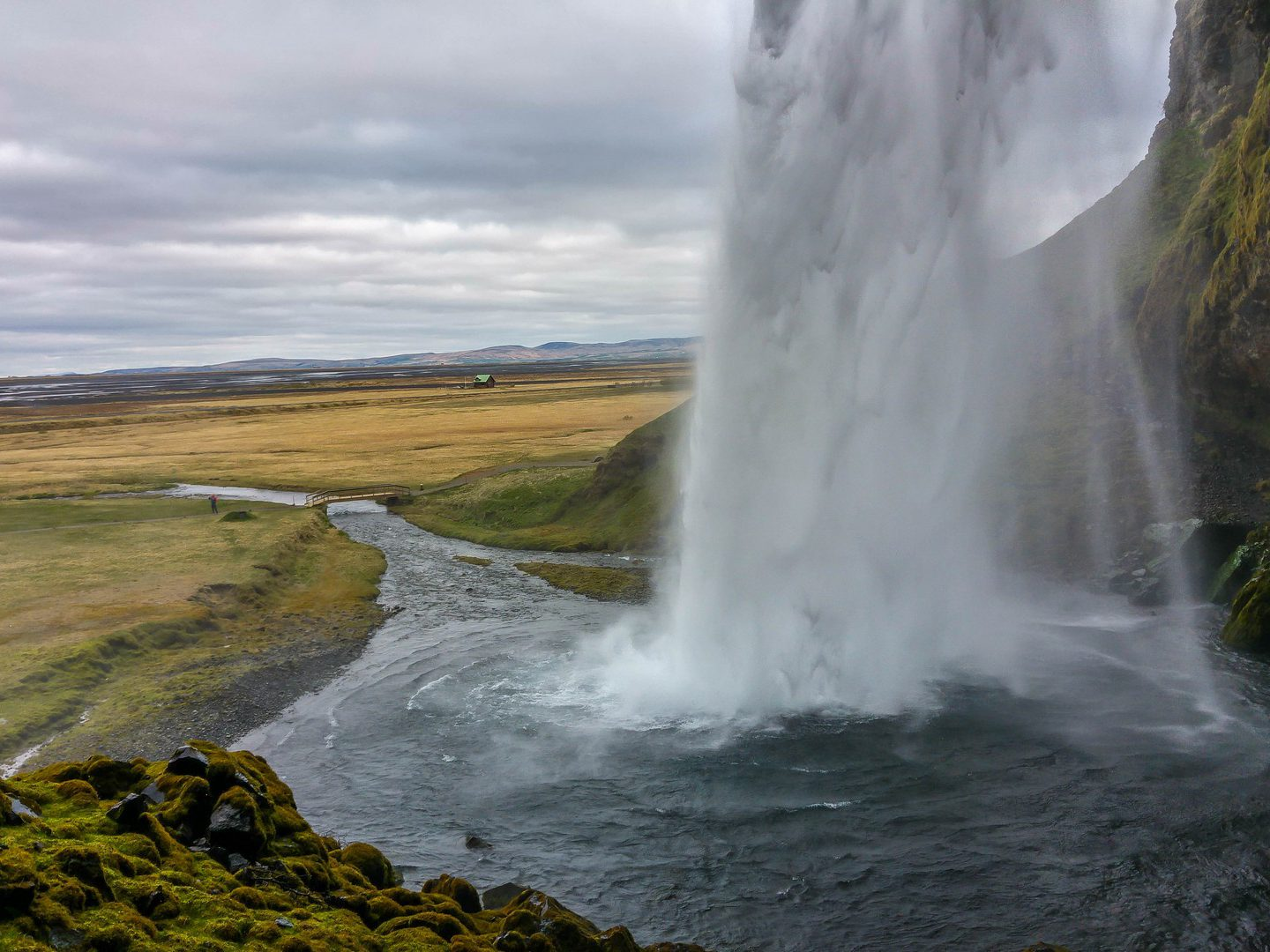 View of Seljalandsfoss waterfall from the backside