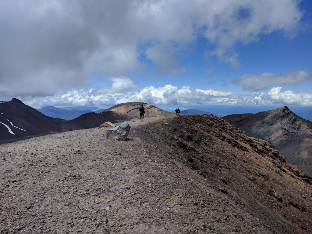 Hikers at summit Red Crater Tongariro Alpine Crossing New Zealand