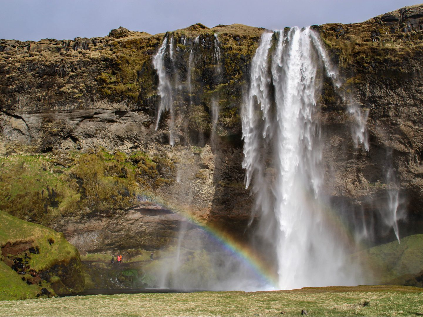 Rainbow arises at Seljalandsfoss waterfall Iceland