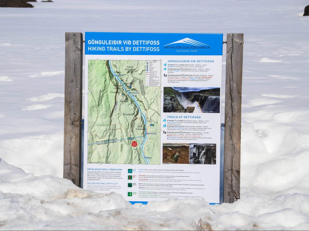 Information board in snow with trails at Dettifoss Iceland