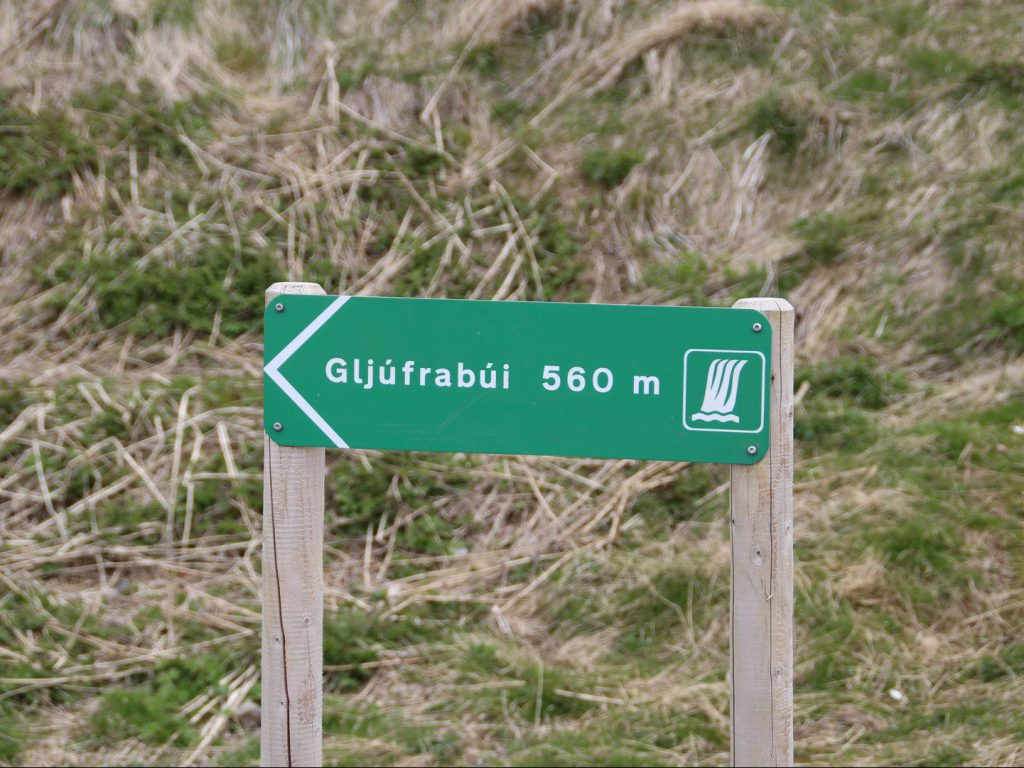 Signpost points to Gljúfrabúi waterfall Iceland