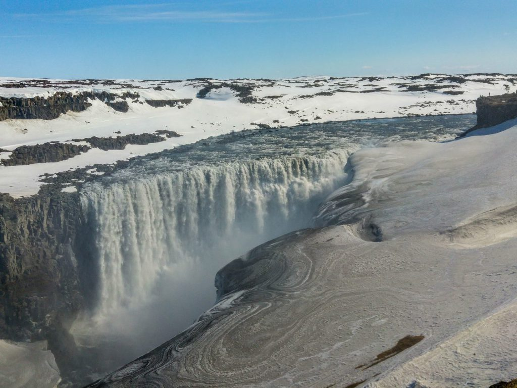 Dettifoss in the middle of a snowy landscape