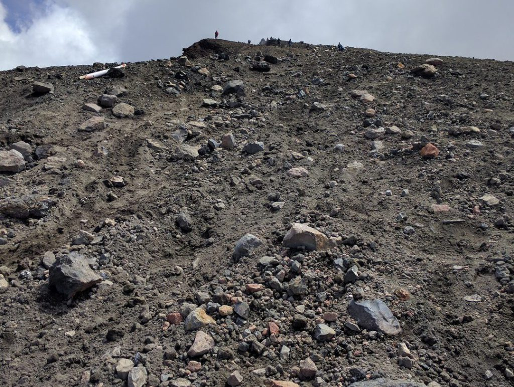 Steep slope Red Crater strewn with stones Tongariro Alpine Crossing New Zealand