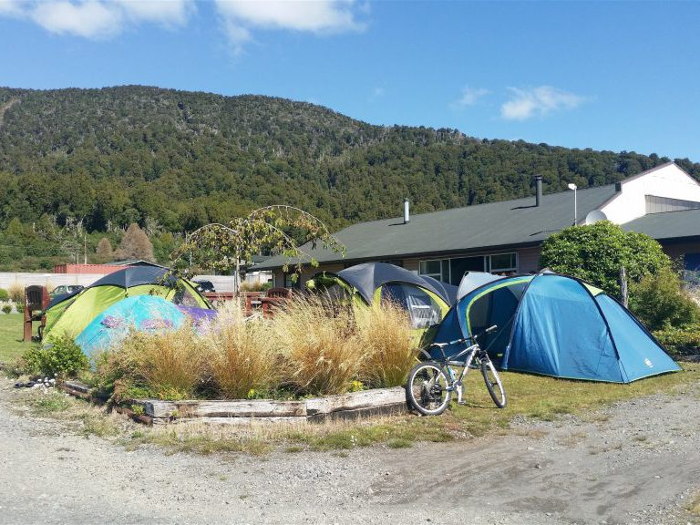 Tents in front yard The Crossing Backpackers Tongariro New Zealand
