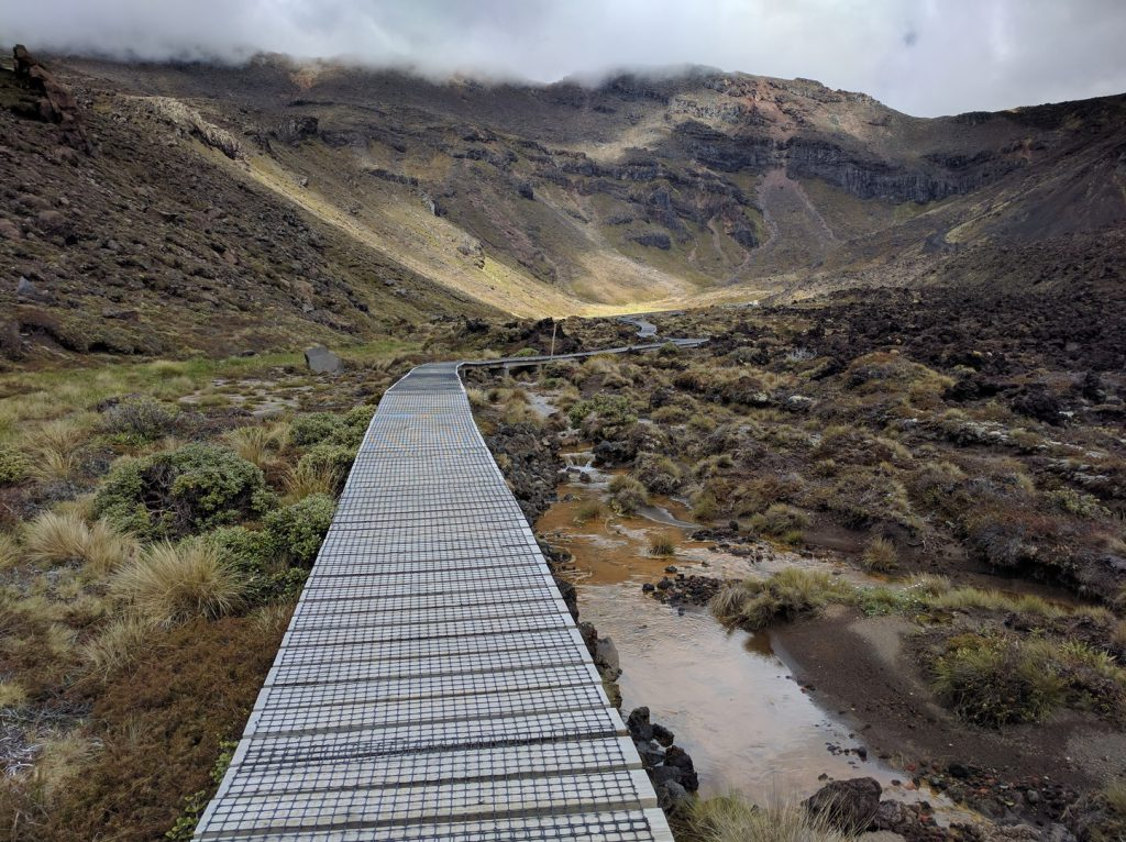 Trail through volcanic landscape Tongariro Alpine Crossing New Zealand