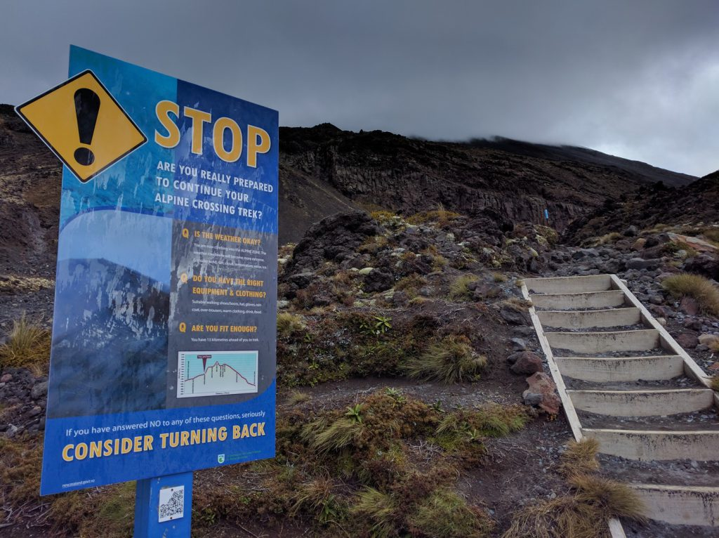 Warning sign and steps at start Devil's Staircase New Zealand