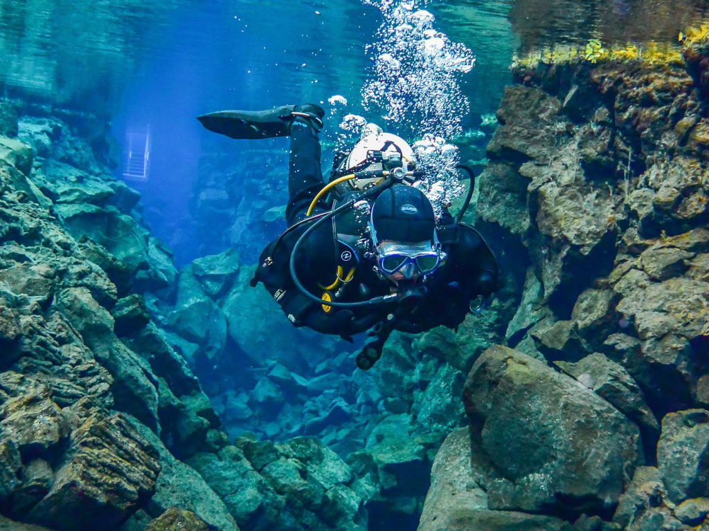 Diver dives at Silfra Fissure Thingvellir National Park Iceland