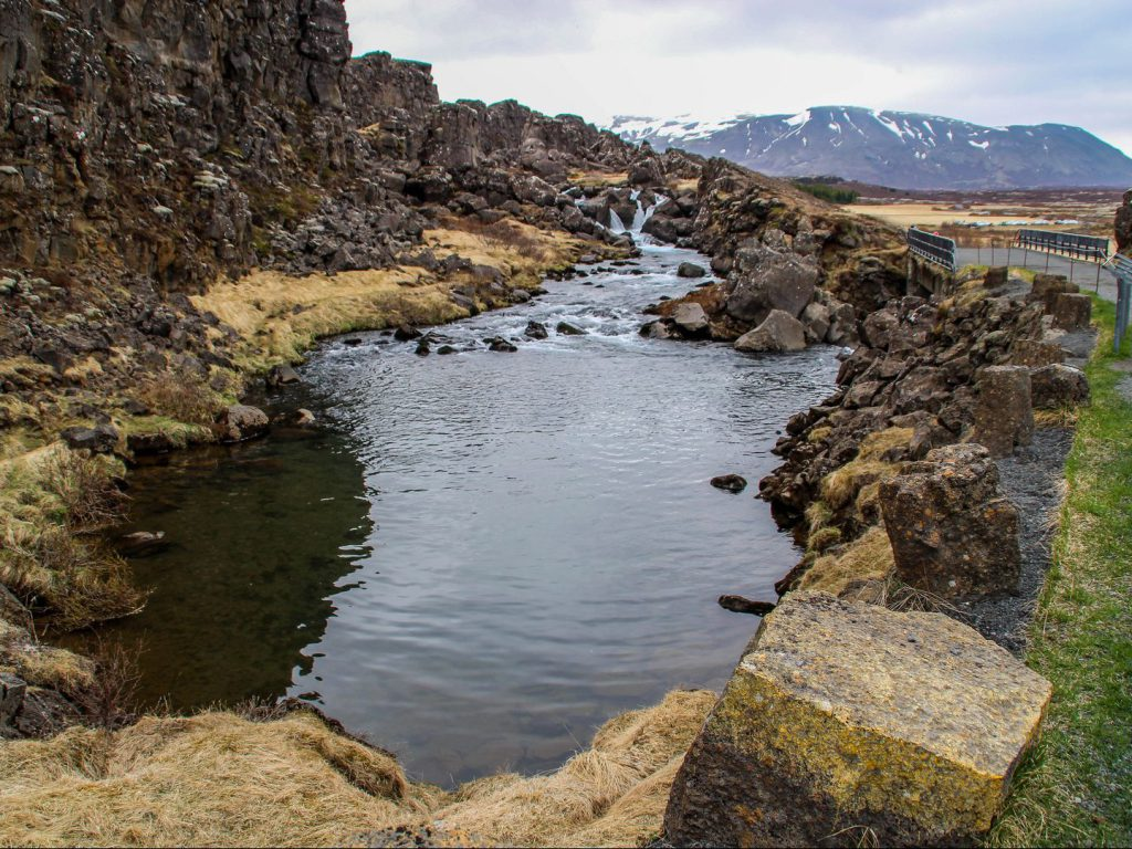 Puddle of water Drekkingarhylur Þingvellir National Park Iceland