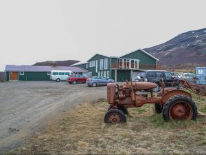 Tractor is parked in front of Efstidalur farm Iceland