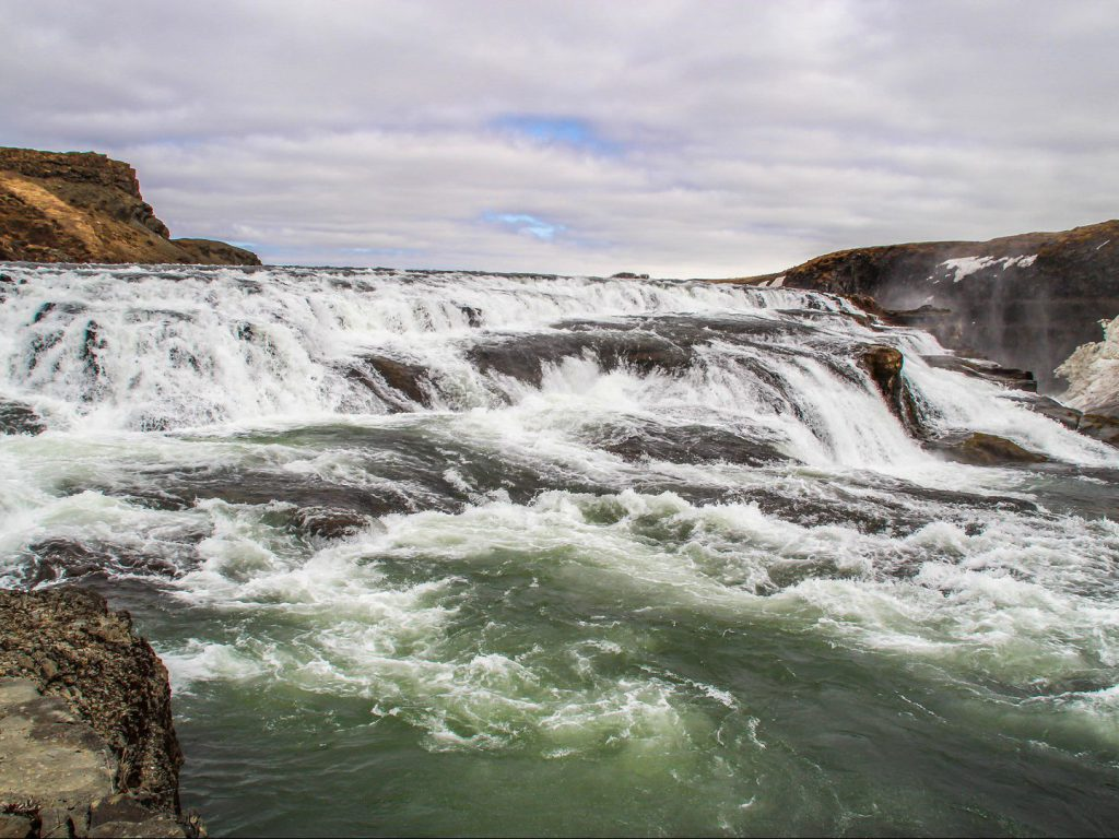 Water flows into the Gullfoss waterfall from the Hvítá glacier river Iceland