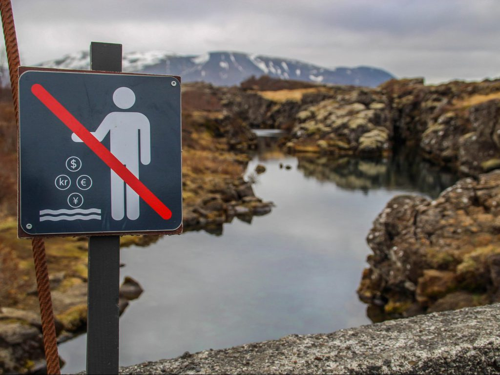 Warning sign at Flosagjá fissure Thingvellir National Park Iceland