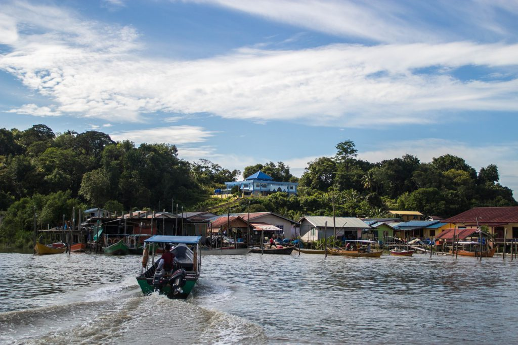 Boats are moored at the banks of the Santubong river Borneo