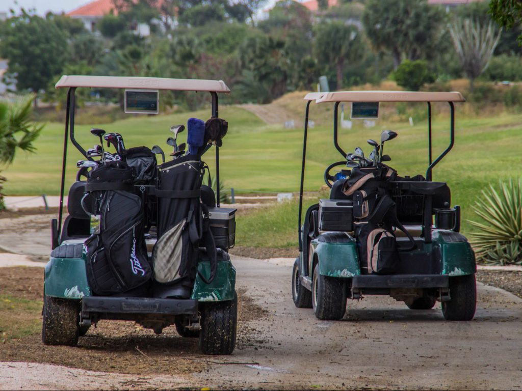2 golf carts on golf course Blue Bay Curaçao