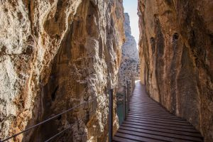 Wooden walkway through Gaitanejo Gorge El Caminito del Rey Spain