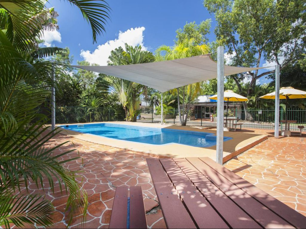 swimming pool and picnic table at Discovery Parks Campground Holiday Park Darwin
