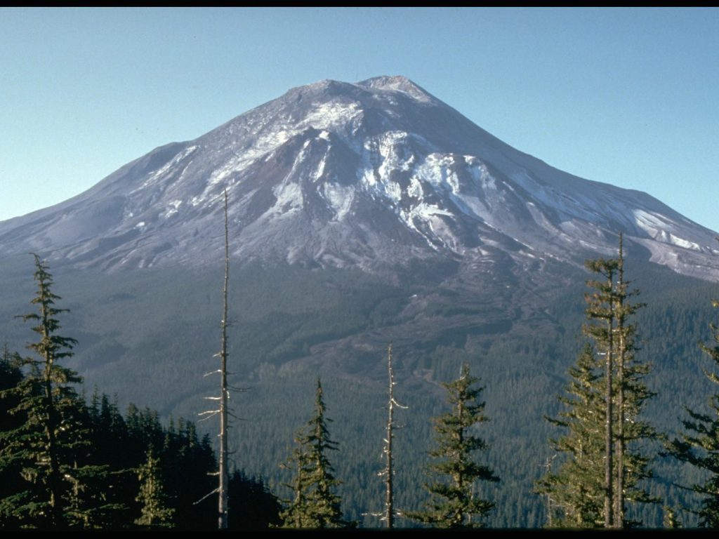 view of landscape with trees and summit volcano Mount St Helens before eruption