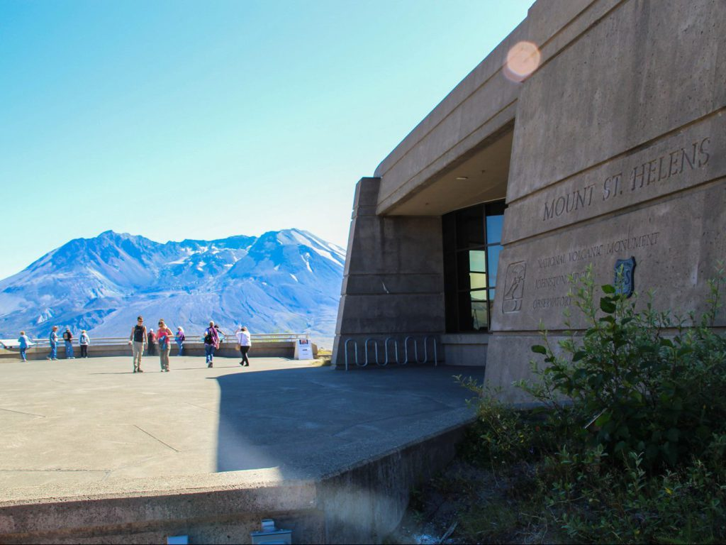 view of volcano Mount St Helens and visitor center Johnston Ridge Observatory