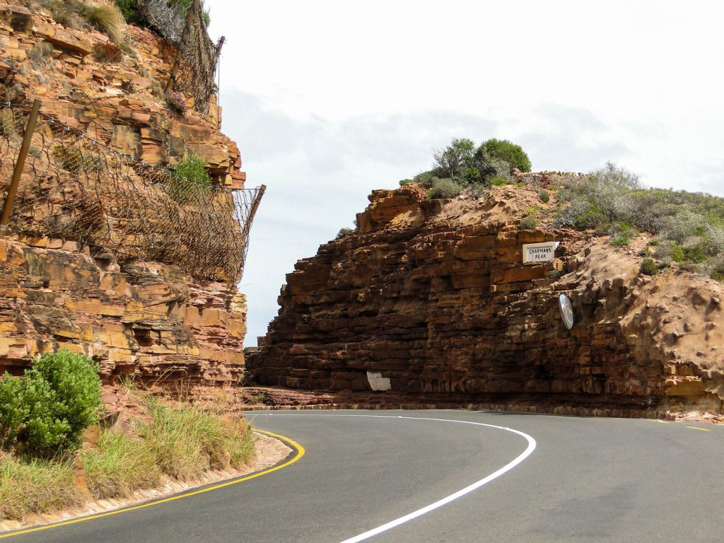 Road between rocks at Chapmans Peak Drive Cape Town South Africa